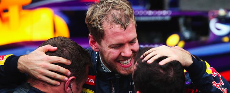 Vettel y Red Bull Premiados